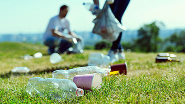 Close up of plastic bottles that lying on the grass